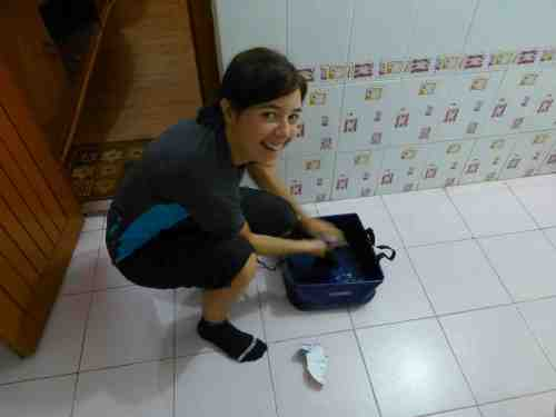 Elsa, washing Marc´s putrid socks!