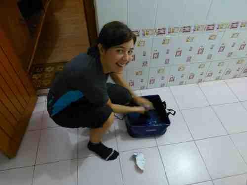 Elsa, washing Marc´s putrid socks!