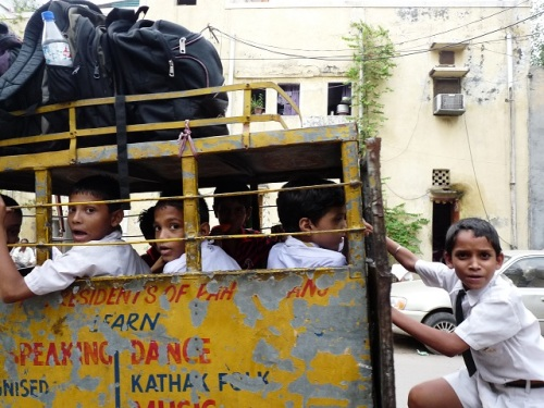 Some kids going home from school outside our hotel in Delhi. They love cameras here.